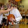 Newburyport: Samantha Baribeault hugs retiring Newburyport High girls basketball coach Neil Reardon after she and Lyndsay Tomasz presented him with a basketball signed by the team. Bryan Eaton/Staff Photo