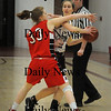 Newburyport: Amesbury's Deryn Zahoruiko puts pressure on Newburyport's Samantha Baribeault. Bryan Eaton/Staff Photo