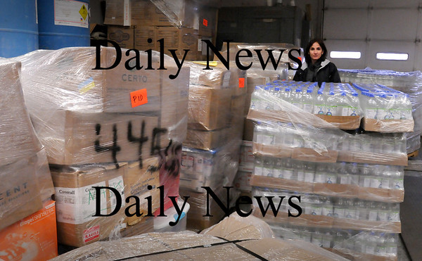 Newburyport: Deb Fargeorge of Partners in Development in Ipswich with containers for a shipment to Haiti at the loading dock at Hawtan Leather in Newburyport's inductrial park which is shipping goods there as well. They have a plant in country. Bryan Eaton/Staff Photo