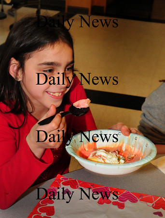 Salisbury: Morgan Hartman, 9, digs in to her bowl of ice cream at a Kid's Club meeting afterschool at Salisbury Elementary on Wednesday. The Salisbury Police Department challenged the students to collect 175 food items for Pettengill House, which they did, then treated them to the ice cream as a reward. Bryan Eaton/Staff Photo