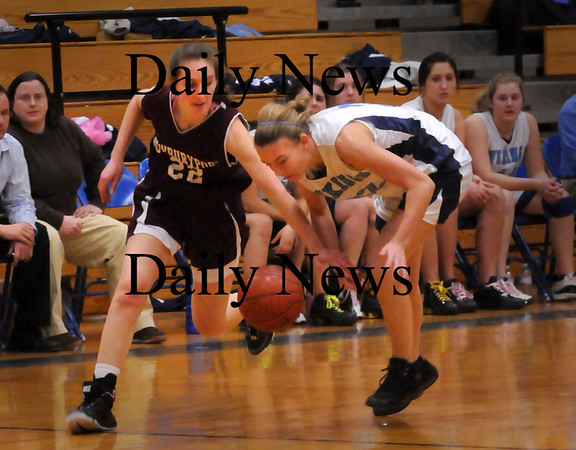Byfield: Newburyport's Samantha Baribeault, left, and Triton's Jen Rock scramble for the ball. Bryan Eaton/Staff Photo