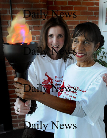 Newburyport: Michele DeMarco Wilkie, of Newbury, left, and Edna Crawford of Newburyport are both heart disease survivors. They and others will carry this torch through seven communities as part of a heart disease awareness program. Bryan Eaton/Staff Photo