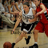 Newburyport: Newburyport's Shawn Crifo moves the ball down court with  Amesbury's Colleen Brockmyre in pursuit. Bryan Eaton/Staff Photo