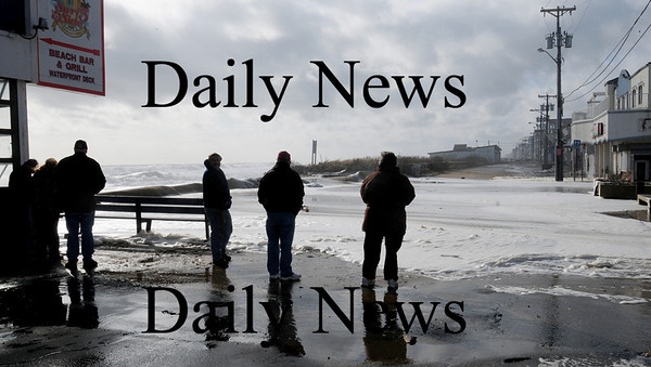 Salisbury: Spectators check out the ocean at high tide Friday morning on Oceanfront at Salisbury Beach. Bryan Eaton/Staff Photo