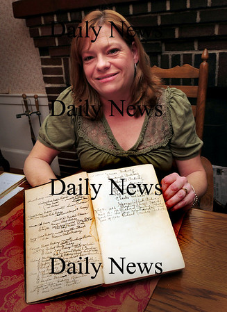 West Newbury: Wendy West of West Newbury with a copy of the 1845 Coffin's History of Newbury in which she's using for research on her master's thesis of Elizabeth Morse who was accused of being a witch. Bryan Eaton/Staff Photo