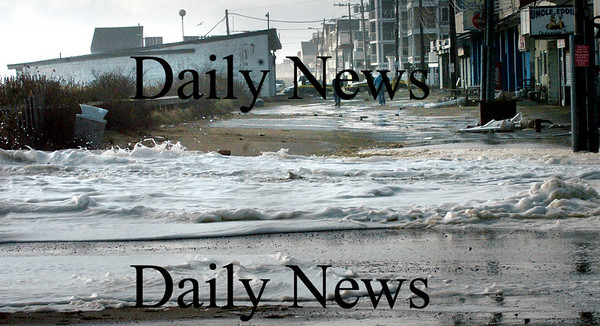 Salisbury: The frothy surf at high tide spills over to Broadway on Friday morning. Bryan Eaton/Staff Photo