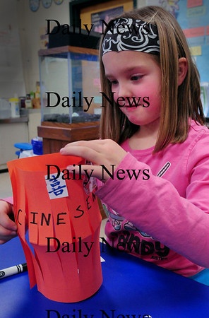 Newburyport: Ruby Hawes, 8, works on her Chinese lantern in John Gangemi's second grade class at the Bresnahan School on Wednesday afternoon. Several students who are from China were teaching the class about the culture and customs. Bryan Eaton/Staff Photo