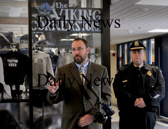 Byfield: Triton Middle School Principal Jared Fulgoni, left, and Newbury Police Chief Michael Reilly at a press conference regarding a seventh-grader bringing a gun into school. Bryan Eaton/Staff Photo