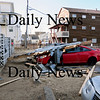 Salisbury: Parts of a roof off some oceanfront property, immediate left, on North End Boulevard in Salisbury landed on these two cars during the storm. Bryan Eaton/Staff Photo