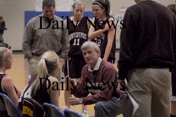 Byfield: Neil Reardon talks to his team at the end of the first quarter against Triton on Tuesday night. Bryan Eaton/Staff Photo