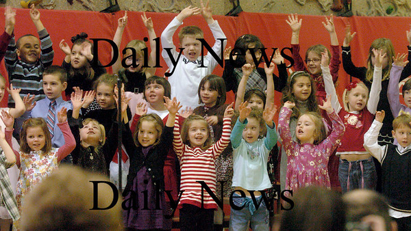 """Amesbury: Kindergartners perform """"She'll Be Comin' Around The Mountain""""  yesterday morning at the Cashman School in Amesbury. The children were performing their annual Valentine show for parents in the gymnasium. Bryan Eaton/Staff Photo"""