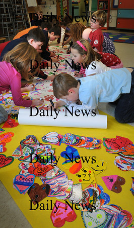 """Newburyport: Students in Mary Ellen Hoiseth's class create hands and hearts in Pam Jamison's art class at the Bresnahan School in Newburyport part of a regional art program """"Hearts For Haiti."""" They are selling the hearts to friends and relatives for $1 with the goal of sending $10,000 for relief in Haiti. Bryan Eaton/Staff Photo"""