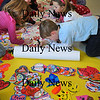 "Newburyport: Students in Mary Ellen Hoiseth's class create hands and hearts in Pam Jamison's art class at the Bresnahan School in Newburyport part of a regional art program ""Hearts For Haiti."" They are selling the hearts to friends and relatives for $1 with the goal of sending $10,000 for relief in Haiti. Bryan Eaton/Staff Photo"
