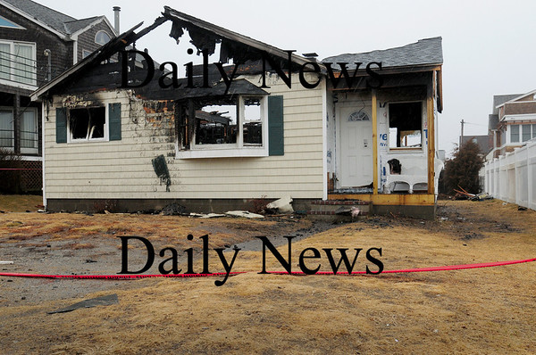 Seabrook: This home at 16 Lawrence Street in Seabrook was destroyed by a fire early yesterday morning. Bryan Eaton/Staff Photo