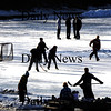 Newburyport:  A group of skaters play hockey on the Frog Pond at the Bartlet Mall in the fading light Monday afternoon. Jim Vaiknoras/Staff photo
