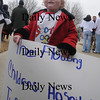 Seabrook:Valerie Noonan 3,of Seabrook hold sign and weres a t-shirt for  Olympian Scotty Lago at a parade in his honor Sunday. Jim Vaiknoras/Staff photo