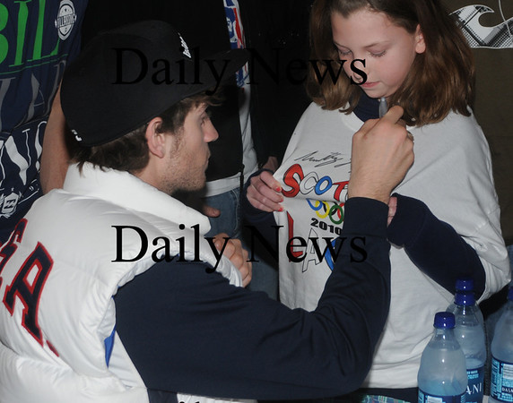 Amesbury: Olympian Scotty Lago signs Jessica Bedrani, 10, of Salisbury shirt  Sunday during an autograph signing at Amesbury Sports Park. About 200 people showed up for the event honoring the Seabrook Bronze medalist. Jim Vaiknoras/Staff photo