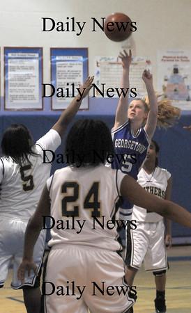 Roxbury: Georgetown's Michelle Reilly hits a jump shot against Fenway Saturday night in Roxbury. Jim Vaiknoras/Staff photo