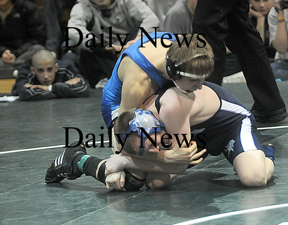 West Newbury: Triton's Joe Chandler wrestles Marbleheads Kristian Kotou at the Division 3 North Sectional Individual Wrestling Tournament at Pentucket high in West Newbury Saturday night. Jim Vaiknoras/Staff photo