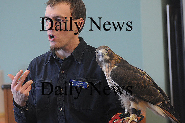 Newburyport: Josh Parker of the Audobon Society talks about the peregrin falcon at the Joppa Center  in Newburyport during the annual Eagle Festival Saturday. JIm Vaiknoras/Staff photo