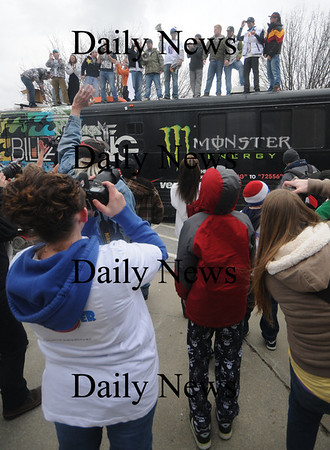 Seabrook:Olympian Scotty Lago arrives at Seabrook Town Hall with his posse  on the roof of a bus at a parade in his honor Sunday. Jim Vaiknoras/Staff photo