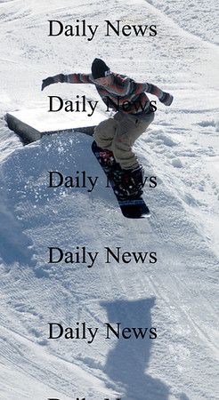 Amesbury: Marty Tamic catches some air as he snowboards at Amesbury Sports Park Saturday afternoon. Jim Vaiknoras/Staff photo