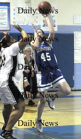 Roxbury: Georgetown's Kelli O'Brien throws up a  shot against Fenway Saturday night in Roxbury. Jim Vaiknoras/Staff photo
