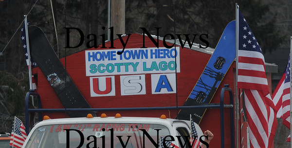 Seabrook:A float honoring Olympian Scotty Lago makes it's way down Rt 1 in Seabrook during a parade in his honor Sunday. Jim Vaiknoras/Staff photo