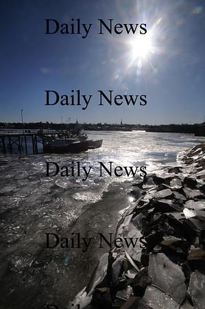 Salisbury: The bright afternoon sun shines off Ice in the Merrimack River near the Bridge Marina in Salisbury Sunday afternoon. JIm Vaiknoras/Staff photo