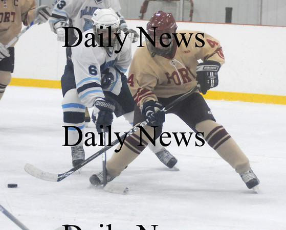 Wilmington: Newburyport's Cameron Roy fights for the puck with Wilmington's John Malone during the Clippers game at Wilmington Saturday. Jim Vaiknoras/Staff photo