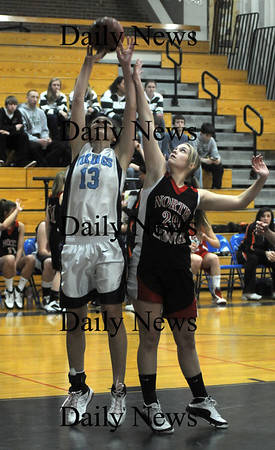 Byfield: Triton's Maxine Crossman grabs a rebound from North Andover's Erika Zahoruiko during the Cape Ann League All Star game Friday night at Triton. Jim Vaiknoras/Staff photo