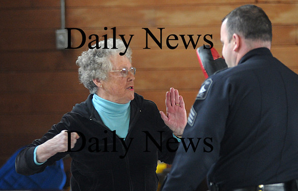 Newburyport:Fran Munroe  participate in a self defense class offered by Sgt. Steven Chaisson and Officer Charles Voderis of the Newburyport Police. In the third week of the four week series, the seniors practices their punches and self awareness techniques.Jim Vaiknoras/Staff photo