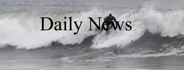 Salisbury: A surfer takes advantage of the high waves off Salsibury Beach Sunday morning. Jim Vaiknoras/Staff photo