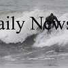 Salisbury: A surfer takes advantage of the high waves off Salsibury Beach Sunday morning. Jim Vaiknoras/Staff photo