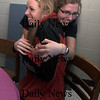 Byfield: Triton's Deanna Latham gets a hug from her freind  Vanessa Short after signing a letter of intent to play at the University of Wisconson. Jim vaiknoras/Staff photo
