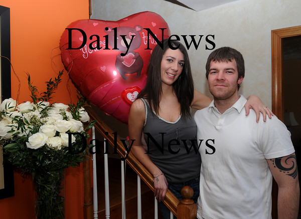 Amesbury: Jay LaValley and Ashley Grimes at their Amesbury home. They won a free wedding from Reason to Give. Jim Vaiknoras/Staff photo