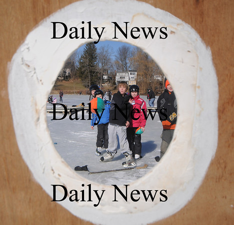 West Newbury: Xander Wilson , 10, tries his luck tossing a football through a target while on skates at the Annual Mill Pond Winter Carnival Sunday in West Newbury. JimVaiknoras/Staff photo