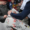 Seabrook:Olympian Scotty Lago signs autographes at Seabrook Town Hall  Sunday. Jim Vaiknoras/Staff photo