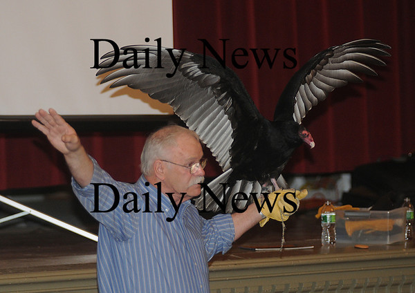 Newburyport: Tom Ricardi of Wind Over Wings, a wildlife rehabilitator group demostrates the wing possition of a turkey vulture in flight at a presentation at City Hall in Newburyport during the annual Eagle Festival Saturday. JIm Vaiknoras/Staff photo