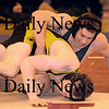 Wakefield:Pentucket's Austin Perrault wrestles Lynnfield/North Reading's Chris O'Conner at the Division 3 North Sectional Wrestling Tournament at Wakefield high Saturday.  Jim Vaiknoras/Staff photo