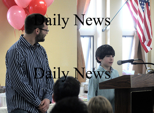 West Newbury: Tyler Van Etten reads speach he wrote in appreciation of his drum teacher Zach Fields at The 20th annual 5th Grade Appreciation<br /> Day celebration at the Paige School in West Newbury Friday. The students select a person to invite to this celebration and write a short speech explaining why this person is important to them, during language arts class.<br /> Jim Vaiknoras/Staff photo