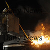 Amesbury: Amesbury firefighters vent the roof at the fire on Pamela Lane in Amesbury Friday night. Jim Vaiknoras/Staff photo