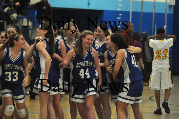 Jamaca Plain: The Georgetown girl basketball team celebrates their victory Thursday night at English High in Jamaca Plain. Jim vaiknoras/Staff photo