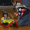 Amesbury: Olympic Luger Erin Warren talks with demostrates luging with the help of Dominic Trembly a student in Susan Keller's class at the Cashman School in Amesbury Friday afternoon. To help with the demostration Dominic put on Warren's full luge suit, including gloves , shoes and number. Jim Vaiknoras/Staff photo