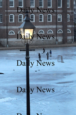 Newburyport: A group of hockey players skate on the Frog Pond at the Bartlet Mall at twilght Friday . Jim vaiknoras/Staff photo