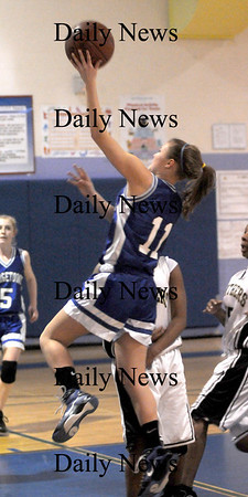 Roxbury: Georgetown's Kristin Hogan glides to the hoop against Fenway Saturday night in Roxbury. Jim Vaiknoras/Staff photo