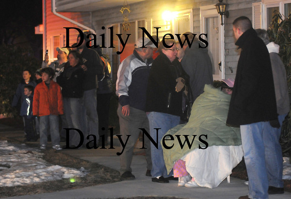 Amesbury: Neighbors bundle up as the watch the fire on Pamela Lane in Amesbury Friday night. Jim Vaiknoras/Staff photo