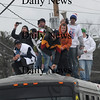 Seabrook: Olympian Scotty Lago ducks under wire on Rt 1 in Seabrook as he and his posse ride on top of a bus in a parade in his honor Sunday. Jim Vaiknoras/Staff photo