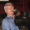 Newburyport: Tom Ricardi of Wind Over Wings, a wildlife rehabilitator group holds a golden eagle at a presentation at City Hall in Newburyport during the annual Eagle Festival Saturday. JIm Vaiknoras/Staff photo