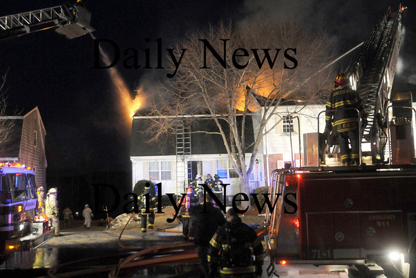 Amesbury: Firefighters battle  the blaze on Pamela Lane in Amesbury Friday night. Jim Vaiknoras/Staff photo